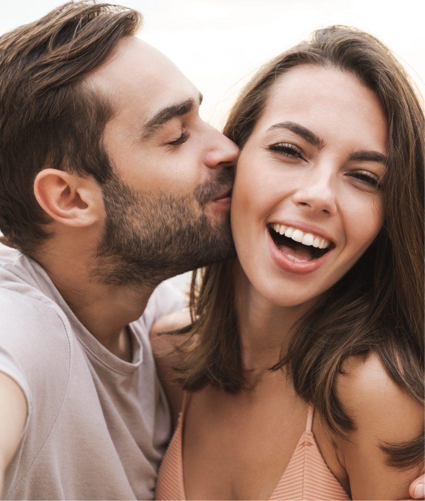 Boyfriend kissing his girlfriend on the cheek