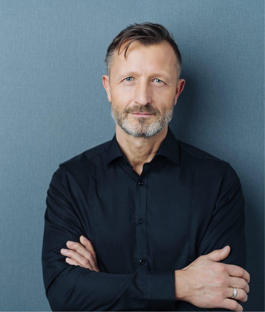 Older man in a dark blue shirt