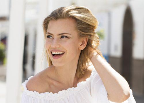 Woman with facial fullness after Juvéderm treatments