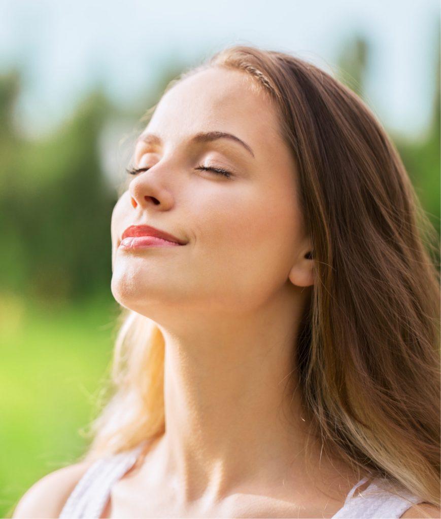 Woman taking in fresh air outside