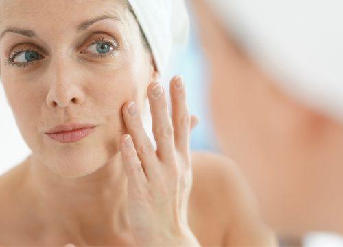Woman suffering from skin laxity