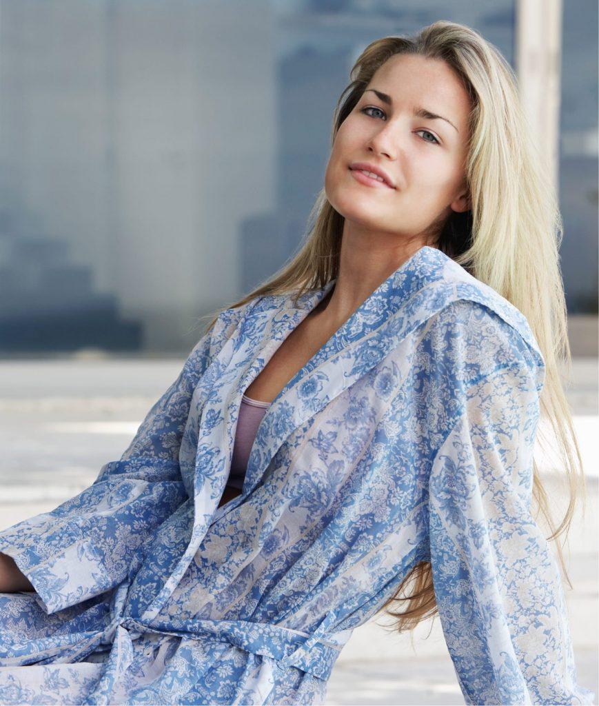 Blonde woman wearing a blue robe
